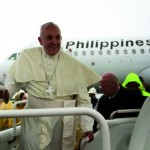 Pope Francis arrives at the Tacloban Airport in Leyte Saturday morning, January 17, 2015, to celebrate holy mass and visit typhoon victim families. Thousands of people, all in raincoats, met the Pope despite heavy rains and strong winds in thge area as typhoon signal number two (2) is raised in leyte and neaby provinces. (Photo by Benhur Arcayan/ Malacanang Photo Bureau)