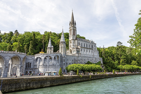 LOURDES, FRANCE - JUNE 06, 2012: The Basilica of our Lady of the Rosary, designed by architect Leopold Hardy, completed in 1899, consecrated in 1901, of a capacity of 1500 worshippers
