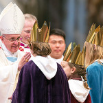 Three children bring Pope Francis the offertory as he celebrates a mass in St. Peter's Basilica at the Vatican, Wednesday, Jan. 1, 2014. (AP Photo/Andrew Medichini)