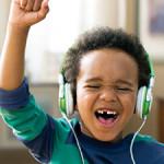 Black boy listening to music on headphones