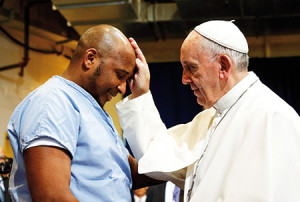 Pope Francis blesses a prisoner as he visits the Curran-Fromhold Correctional Facility in Philadelphia Sept. 27. (CNS photo/Paul Haring) See POPE-PRISON Sept. 27, 2015.